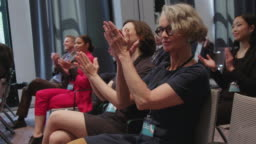 Business professionals applauding during seminar