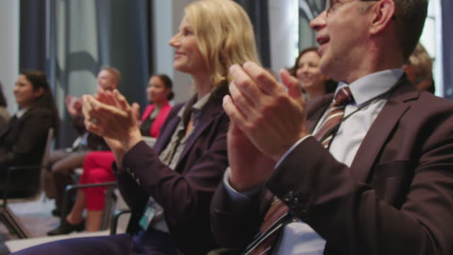 business professionals applauding during seminar - auditorium stock videos & royalty-free footage