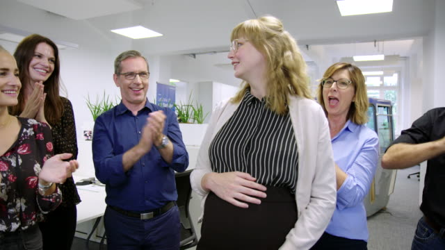business professionals applauding to pregnant colleague - ladder of success stock videos & royalty-free footage