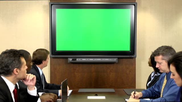 business professionals in front of chroma key monitor - media training stock videos and b-roll footage