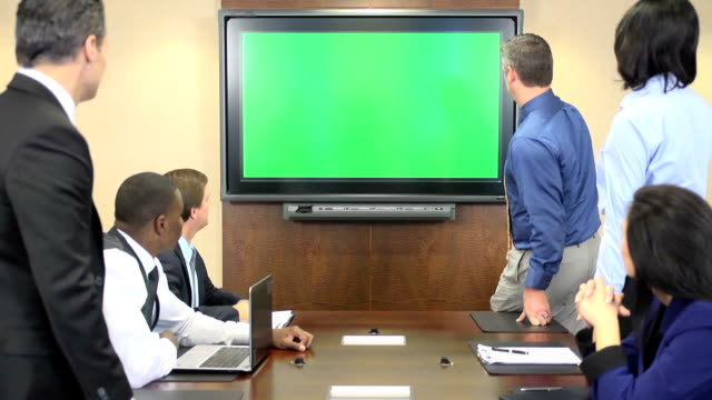 business professionals in front of chroma key monitor - hiking pole stock videos and b-roll footage