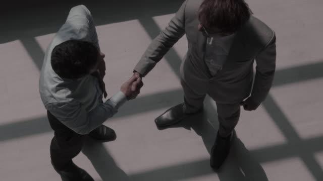 取引関係 - handshake点の映像素材/bロール