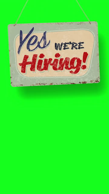 yes, we're hiring! business sign drops and swings down with room for copy below - classified ad stock videos & royalty-free footage