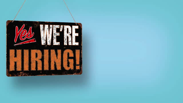 yes, we're hiring! business sign drops and swings down with room for copy - classified ad stock videos & royalty-free footage