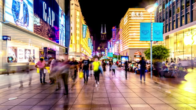business street with crowded people at night in shanghai. timelapse - shanghai stock videos & royalty-free footage