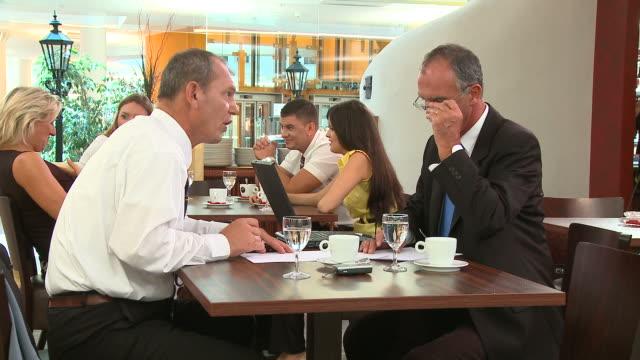 hd: business talk - business talk stock videos & royalty-free footage