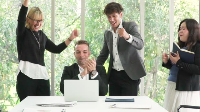 business team celebrating their success in the office - fist stock videos & royalty-free footage