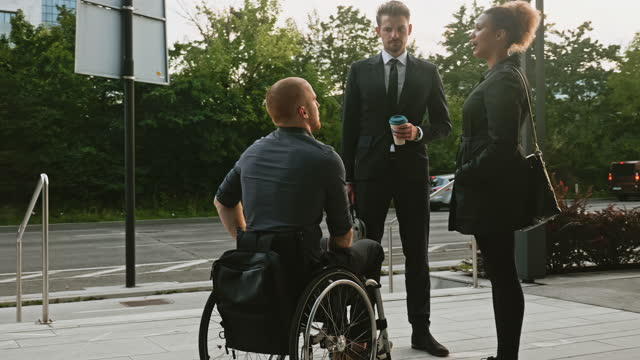 business team conversing at entrance to office building - persons with disabilities stock videos & royalty-free footage