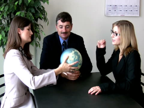 business team discusses global prospects - employee engagement stock videos & royalty-free footage
