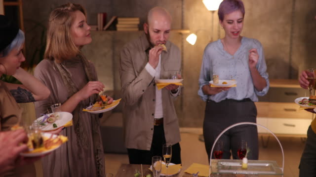 business team eating tasty food during networking event at modern office - standing stock videos & royalty-free footage