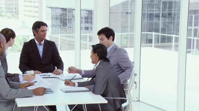 ms ds business team having discussion in office / cape town, south africa - abbigliamento da lavoro formale video stock e b–roll
