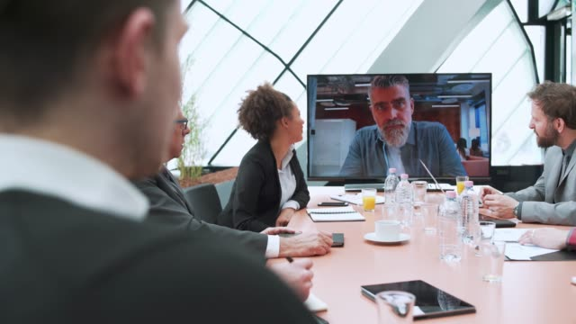 business team having video call with their manager - liquid crystal display stock videos and b-roll footage