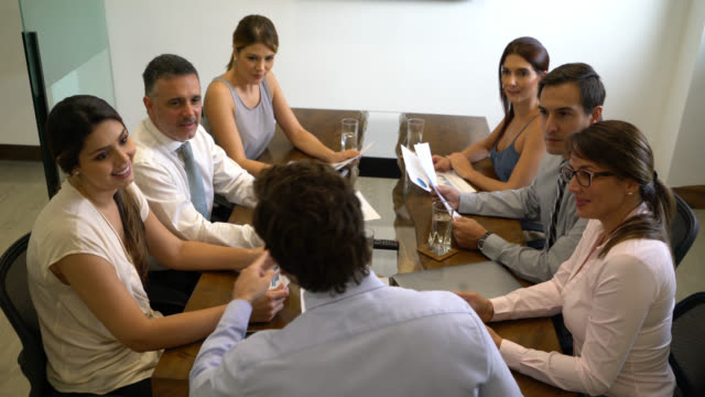 business team in a meeting at the conference room all pitching ideas to male manager - sales pitch stock videos & royalty-free footage