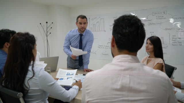 business team in a meeting with their manager brainstorming ideas - sales occupation stock videos & royalty-free footage