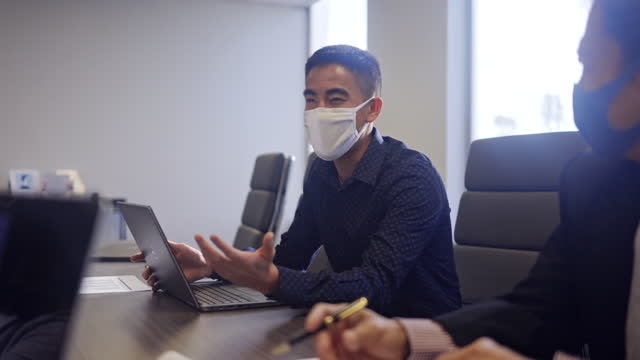 business team meeting in conference room with masks - filipino ethnicity stock videos & royalty-free footage