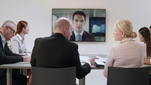 同僚とのビデオ会議会議の ds 事業チーム - 会議点の映像素材/bロール