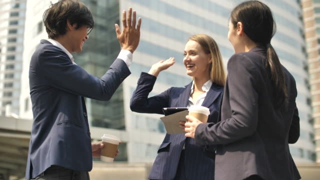 business team people high fiving in celebration success - business person stock videos & royalty-free footage