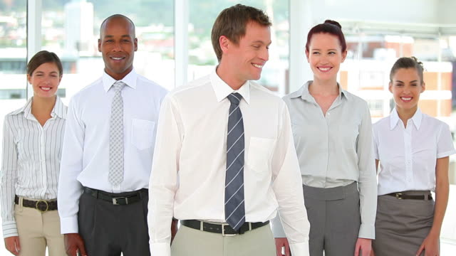 Business team standing together and smiling
