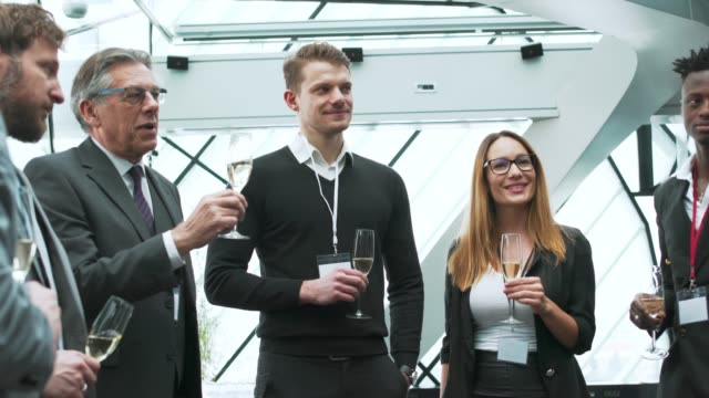 business team toasting during a break - formal stock videos & royalty-free footage