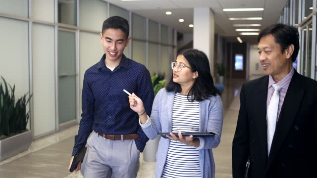 business team walking down a hallway - filipino ethnicity stock videos & royalty-free footage