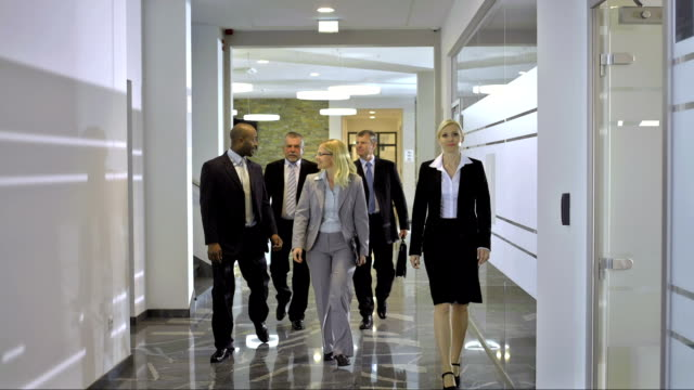 ds ls business team walking down the corridor - corridor stock videos & royalty-free footage