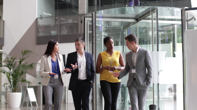 Business team walking through office reception