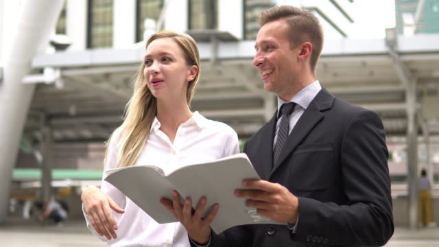 business team with papers working - employee engagement stock videos & royalty-free footage