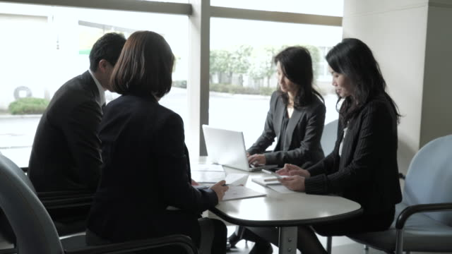 business team working in casual meeting - staff meeting stock videos & royalty-free footage
