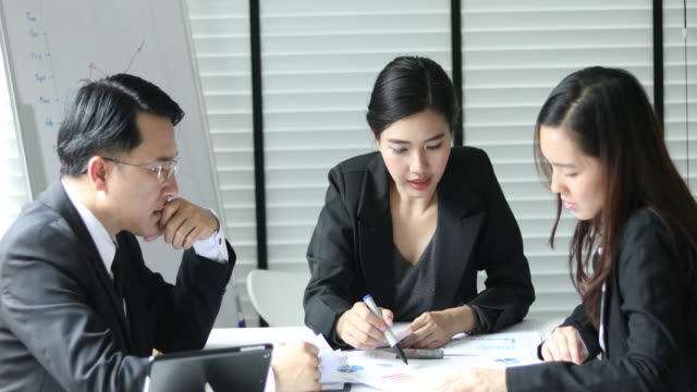 business team working in casual meeting - japanese ethnicity stock videos & royalty-free footage