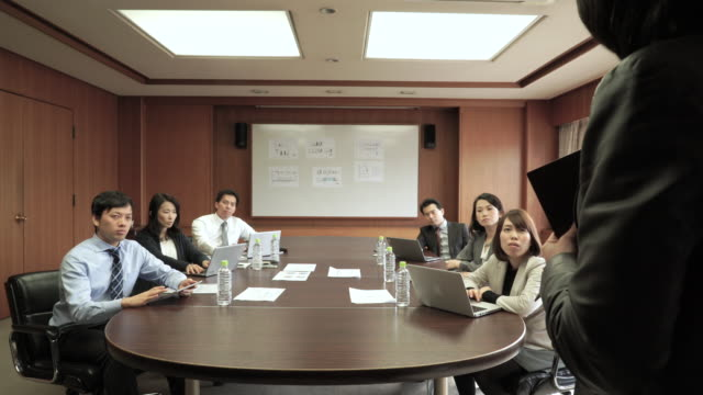business team working in meeting room - staff meeting stock videos & royalty-free footage