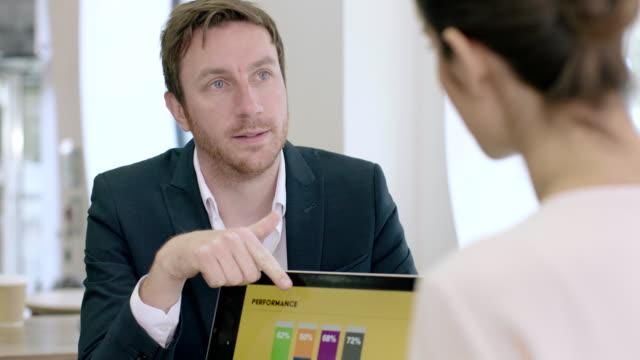 business team working together on presentation - strategia di vendita video stock e b–roll