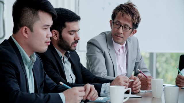 business team working together - southeast asia stock videos & royalty-free footage
