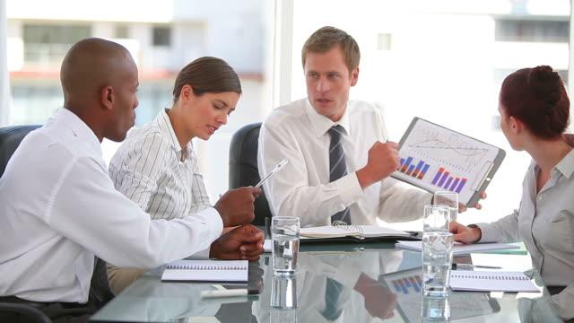 business team working with graphs - hemd und krawatte stock-videos und b-roll-filmmaterial