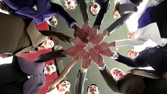business teamwork groups of multi-ethnic people stacked hand together, unity concept. shot from bottom view. - unità video stock e b–roll