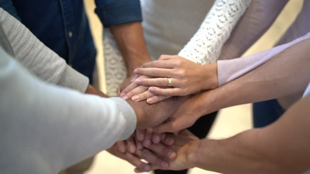 business teamwork joining hands team spirit collaboration concept - hands clasped stock videos and b-roll footage