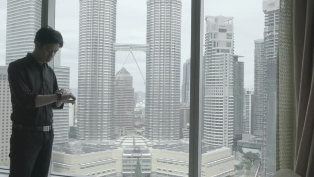 business travel business man working in hotel room - malaysia stock videos and b-roll footage