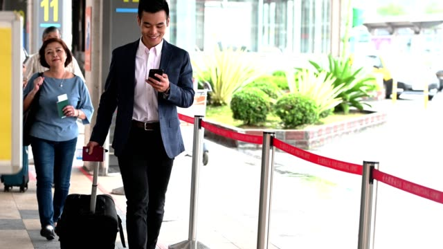 business traveler in a taxi queue - taxi stand stock videos and b-roll footage