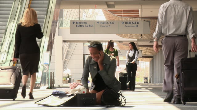 business traveler searching through clothes on airport floor - handbag stock videos and b-roll footage