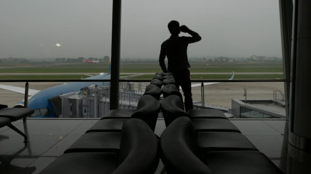 Business Travelers silhouettes at airport Terminal