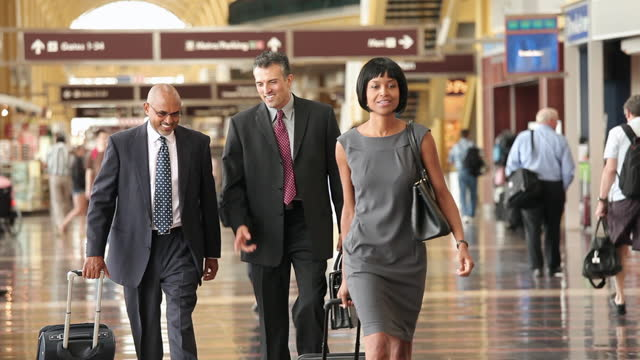 business travelers walking through airport terminal - gate stock videos & royalty-free footage