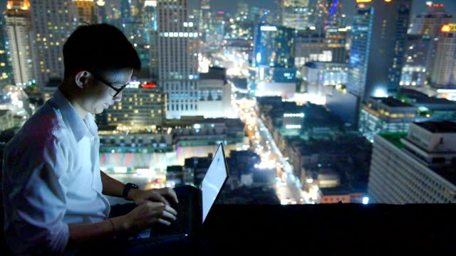 business using laptop and digital tablet at skyscaper background - oriental culture stock videos & royalty-free footage