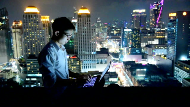 Business using laptop and digital tablet at skyscaper background