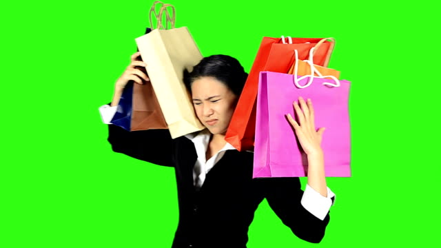 business woman carry shopping bags on the back - keyable stock videos & royalty-free footage