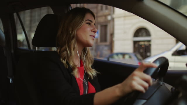 business woman commuter, driving car in rome - singing stock videos & royalty-free footage