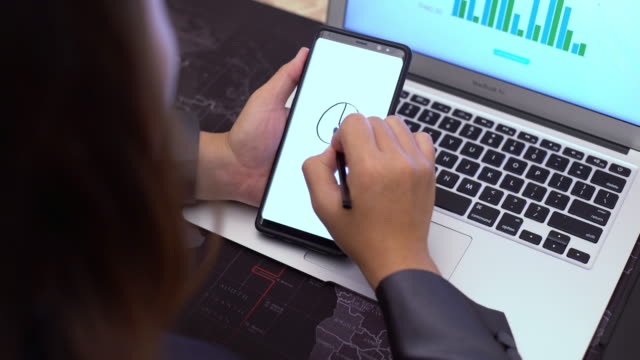 Business woman drawing is smart phone for business