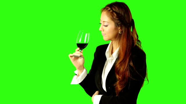 business woman drinking wine with green screen background - keyable stock videos & royalty-free footage