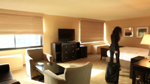 Business Woman entering hotel room