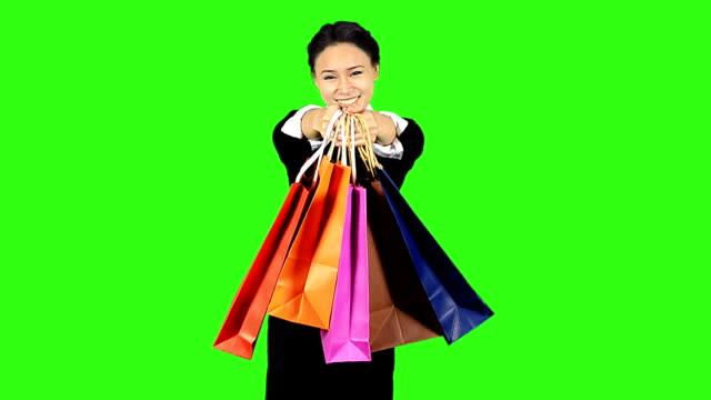business woman giving shopping bag with green screen background - keyable stock videos & royalty-free footage