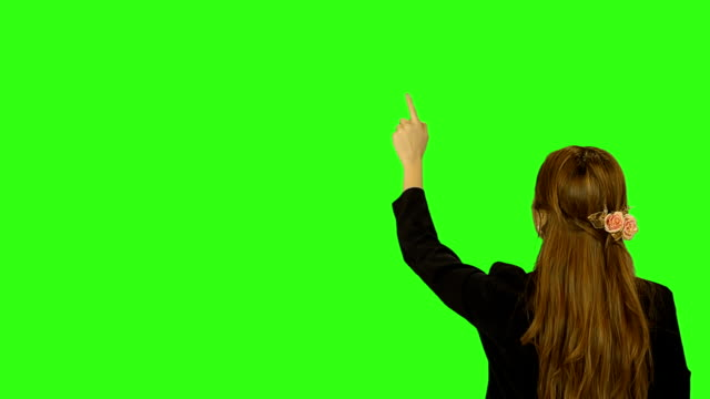 business woman hand moving touchscreen with green screen background - touch sensitive stock videos and b-roll footage