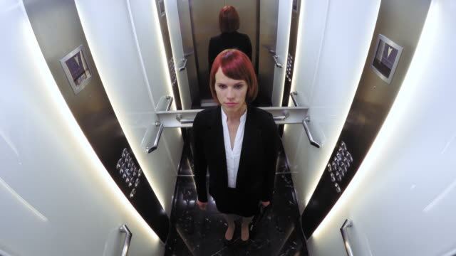 POV Business woman in the elevator